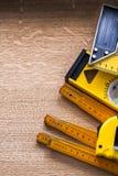 Set objects of measurement on oaken wooden board Stock Photography