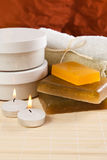Set objects for spa. Treatments, such as soaps, towels and moisturizer Stock Photography