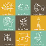 Set of objects and symbols on the cinema theme. Royalty Free Stock Photo