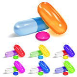 Set of oblong and elliptical multicolored capsules and round pil Royalty Free Stock Photography