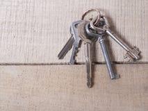 Set od assorted different keys on wooden background