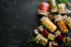 Free Set Of Canned Vegetables And Mushrooms In Glass Jars. Set Of Pickled Food On Black Stone Background. Royalty Free Stock Photos - 183991078