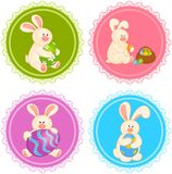 Set Of Easter Bunnies With Colored Eggs Stock Images