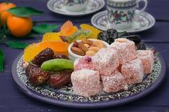 Set Of Eastern Desserts. Marmalade, Kivi, Prunes, Rahat Lokum, Nuts, Mandarin, Persimmon, Dried Apricots, Pistachios, Dates, Raisi Stock Photography
