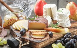Free Set Of Fine Cheeses With Fruit And Honey Royalty Free Stock Photo - 99367755