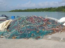Free Set Of Fishing Nets And Ropes Of Different Sizes And Colors On A Pier Stock Photos - 161798673