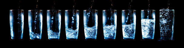 Set Of Glasses With Water And Ice Stock Photography