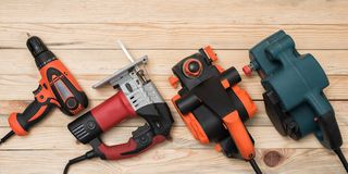 Free Set Of Hand Carpentry Power Tools For Woodworking Lies On A Light Wooden Background. Directly Above Royalty Free Stock Photo - 153688535