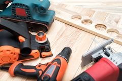Free Set Of Handheld Woodworking Power Tools For Woodworking And Workpiece Lies On A Light Wooden Background. Close Up Stock Photography - 156677722