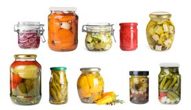 Free Set Of Jars With Pickled Vegetables And Feta Cheese On Background Royalty Free Stock Image - 182114776