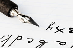 Set Of Letters And Black Ink Nib Of Drawing Pen Royalty Free Stock Photo