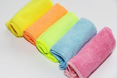 Free Set Of Multi-colored Microfiber Rags For Cleaning. Five Colored Towels On A White Background Royalty Free Stock Photos - 140381528