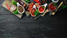 Free Set Of Red Sauces On A Wooden Background. Ketchup, Barbecue Sauce, Tomato Sauce. Top View. Royalty Free Stock Photography - 164652747