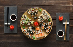 Free Set Of Sushi Maki And Rolls On Black Rustic Wood, Top View Royalty Free Stock Photography - 92881837