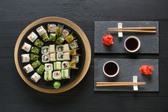 Free Set Of Sushi Maki And Rolls On Black Rustic Wood, Top View Stock Photos - 92962473