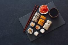 Set Of Sushi Rolls Served On Stone Slate Royalty Free Stock Photo