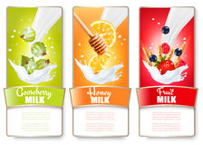 Set Of Three Labels Of Fruit And Berries In Milk Splashes. Royalty Free Stock Image