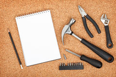 Set Of Tools On Cork Background Royalty Free Stock Photos