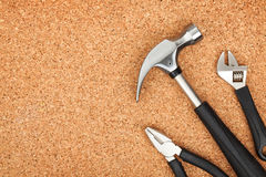 Set Of Tools On Cork Background Stock Photography