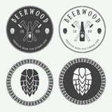 Set Of Vintage Beer And Pub Logos, Labels And Emblems With Bottles, Hops, Axes And Wheat Stock Photos