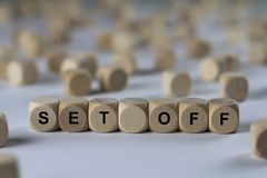 Set off - cube with letters, sign with wooden cubes Stock Photography