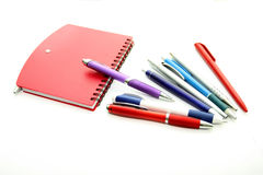 Set of office pens and red notebook Royalty Free Stock Image