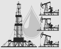 Set of oil pumps and rig silhouettes. Detail vector illustration Stock Image