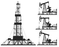 Set of oil pumps and rig silhouettes. Isolated on white. Detail vector illustration Stock Photos