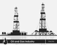 Set of oil rigs silhouettes. Detailed vector illustration over grey background Royalty Free Stock Photos