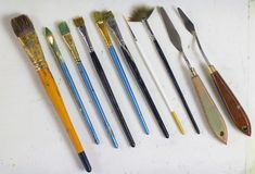 Set of old art brushes and palette knives, palette knots. The artist`s tools. Brushes for painting.art supplies Stock Photos
