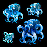 Set of old blue octopuses on a black background Stock Images