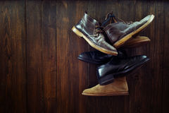 Set of old boots hanging on the nail Royalty Free Stock Image