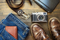 Set of old boots on wooden background Royalty Free Stock Photos
