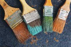 Set of old brush for coloring the walls on iron background. Set of old brush for coloring the walls royalty free stock photos