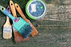 Set of old brush for coloring the walls. Paintbrush on wood background Stock Images