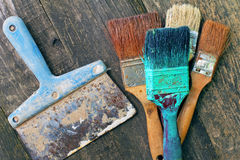 Set of old brush for coloring the walls. Paintbrush on wood background. Set of old brush for coloring the walls royalty free stock photo