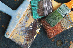 Set of old brush for coloring the walls and spatula on iron background. Set of old brush for coloring the walls and spatula royalty free stock photos