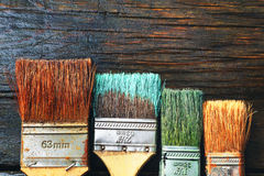 Set of old brush for coloring the walls on wood background. Set of old brush for coloring the walls royalty free stock photography