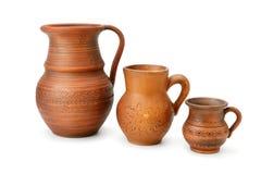 Set of old ceramic pot and mug isolated on white background. Stock Images