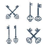 Set of old crossed keys silhouettes. Royalty Free Stock Images