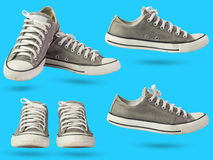 Set of old dirty sneakers. Set of old dirty sneakers laying on isolate blue background royalty free stock photo