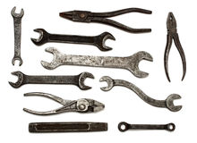 Set of old dirty tools. Spanners and pliers - isolated on white royalty free stock photography