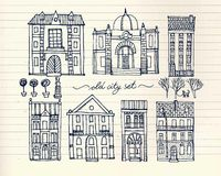 Set of old hand drawn vintage houses on paper background. Set of cute hand drawn cartoon buildings on paper background Stock Photo