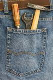 set of old instruments in a back pocket of a jeans Royalty Free Stock Photography