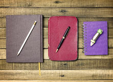 Set old notebook and pencil on wood background Stock Photo
