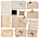 Set of old paper sheets, book, envelope, postcards. Isolated on white background Stock Images