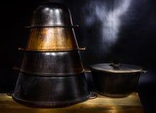 Set of old pig-iron east cauldrons Stock Photos