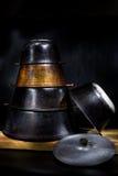 Set of old pig-iron east cauldrons Stock Photo