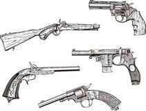 Set of old revolvers and pistols Royalty Free Stock Photos