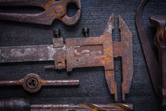 Set  of old rusted tools on vintage board Stock Photography